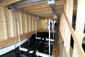 Boathouse Lifts Gallery - image Alumator-Hi-Speed-in-Boathouse-300x200 on https://www.iqboatlifts.com