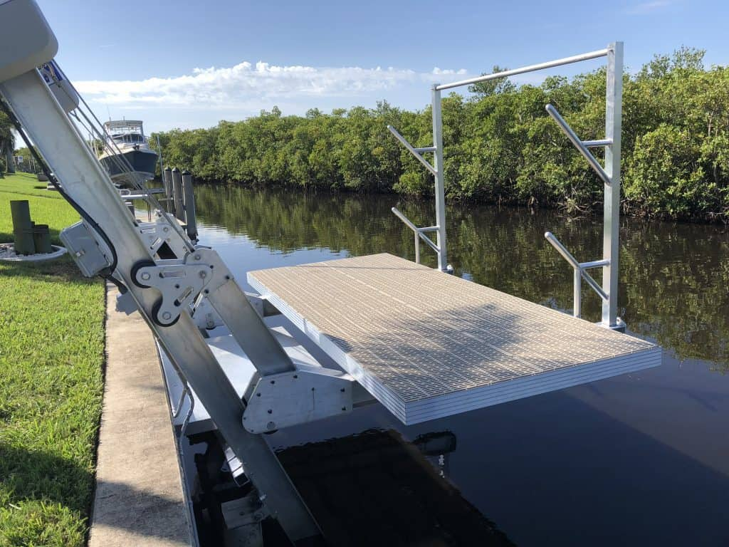 Boat Lift Accessories for Lifting, Docking, Storing and Making Repairs - image Elevator-deck-lift-with-access-platform-and-kayak-rack-1024x768 on https://www.iqboatlifts.com