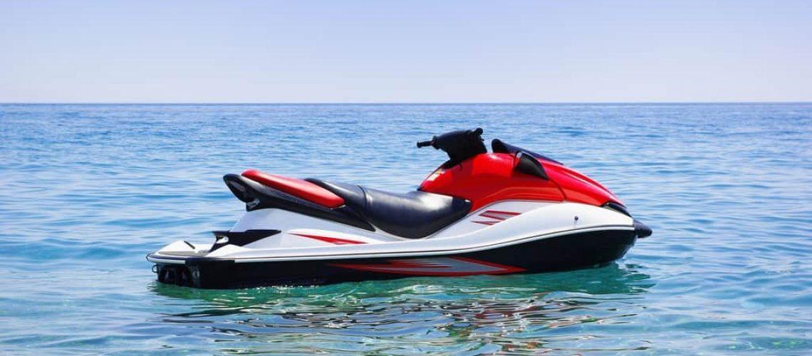 Red jet ski in the sea